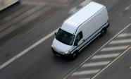 Fast moving truck on asphalt road